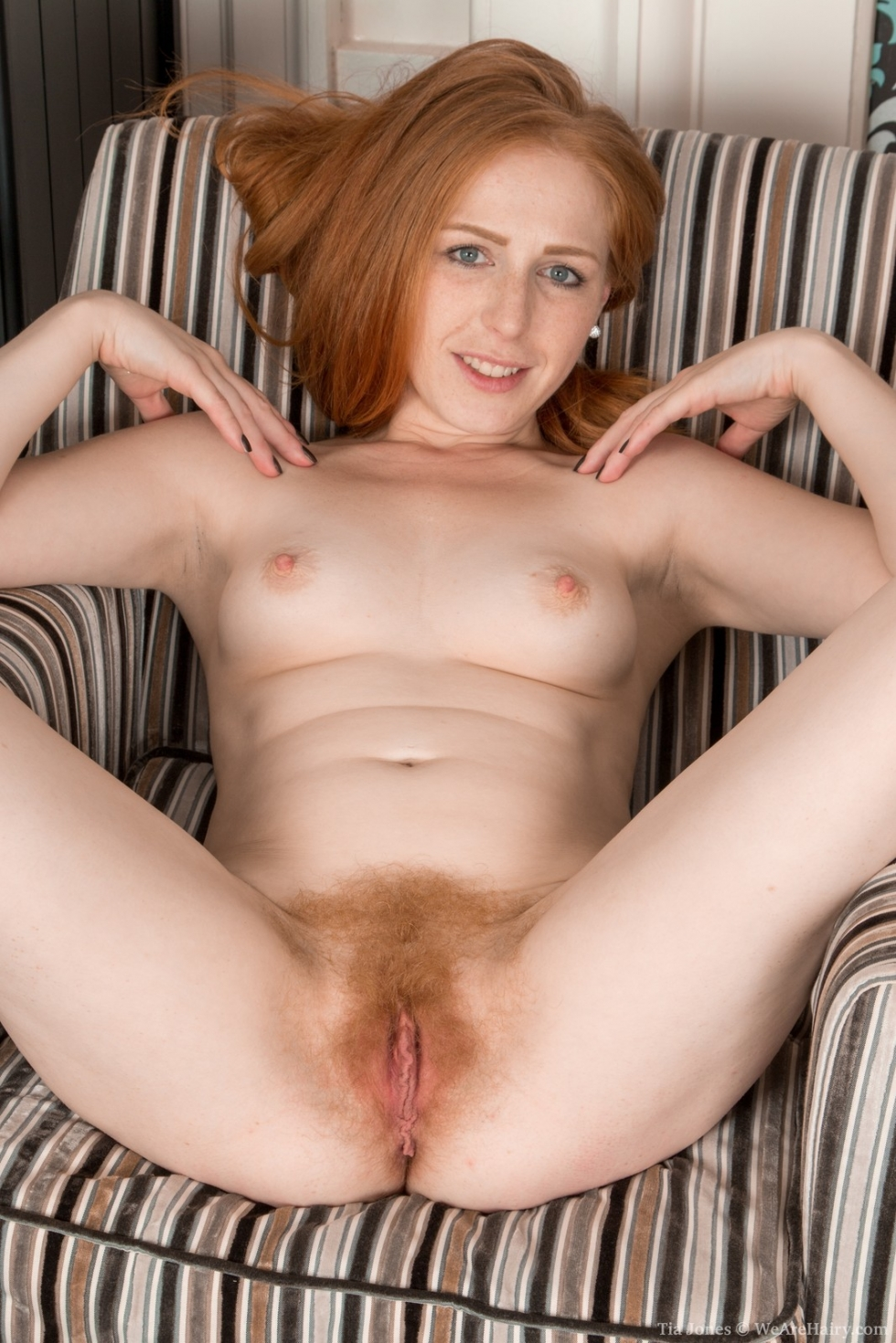 Horny red head spreads her tight wet pussy 7